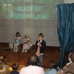 The narrator, Alice and her sister on stage